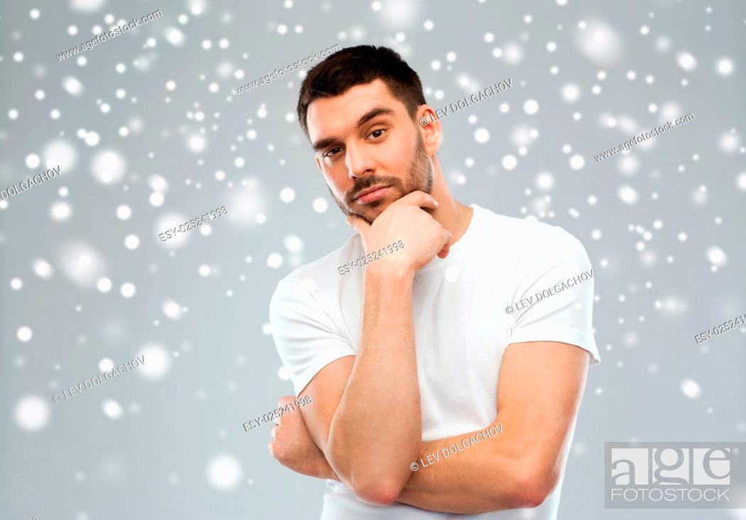 Stock Photo: doubt, winter, christmas and people concept - man thinking over snow on gray background.