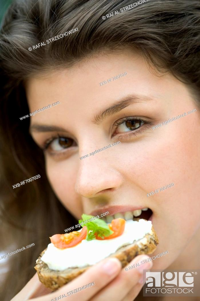 Stock Photo: Young woman with sandwich.