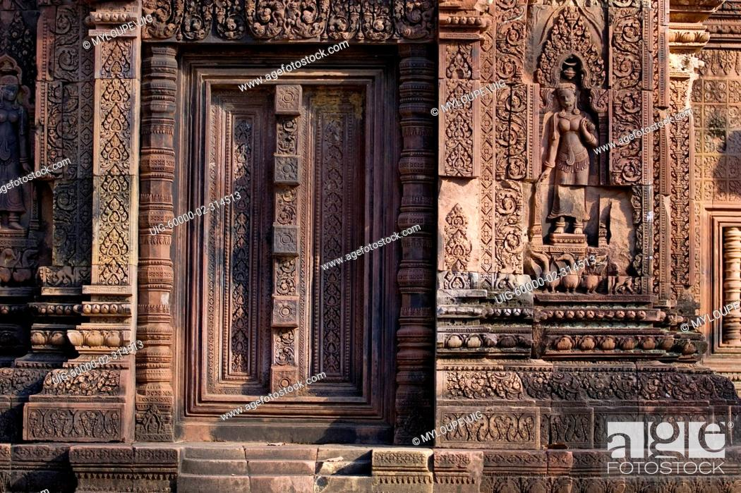 Stock Photo: Hindu temple door with Apsara celestial maiden at Banteay Srei, 10th century Khmer architecture at Angkor Wat - Siem Reap, Cambodia.