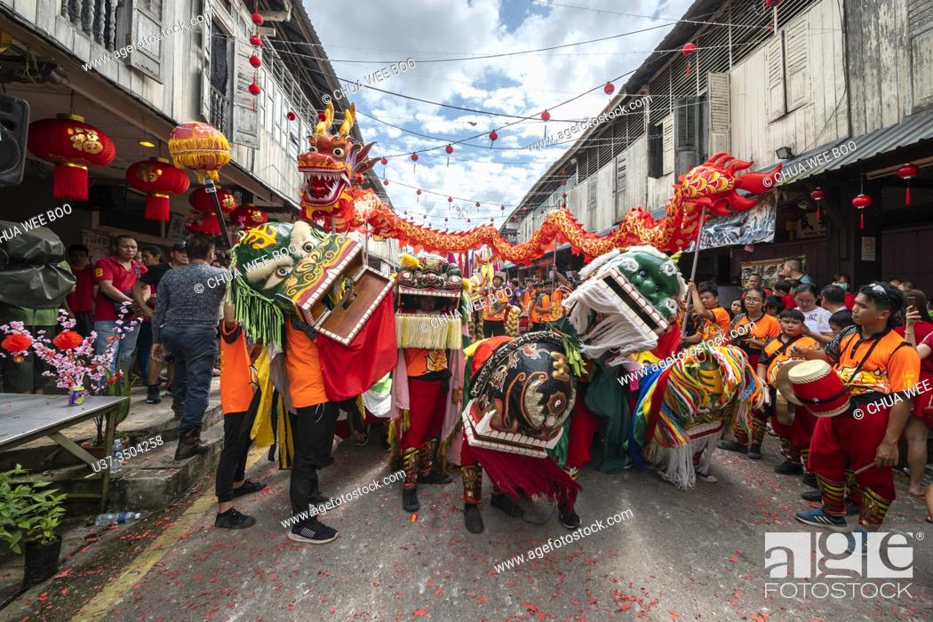 Stock Photo: Dragon and lion dance during Chinese New Year Festival Capgomeh year 2020 15th day of the 1st month at Siniawan, Sarawak, Malaysia.