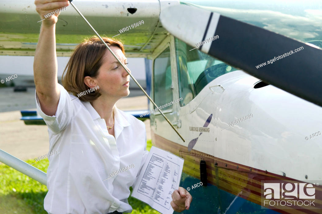 Stock Photo: Woman, with, sporting, airplane,.