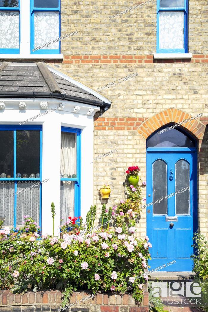 Stock Photo: Blue Door Cottage Facade.
