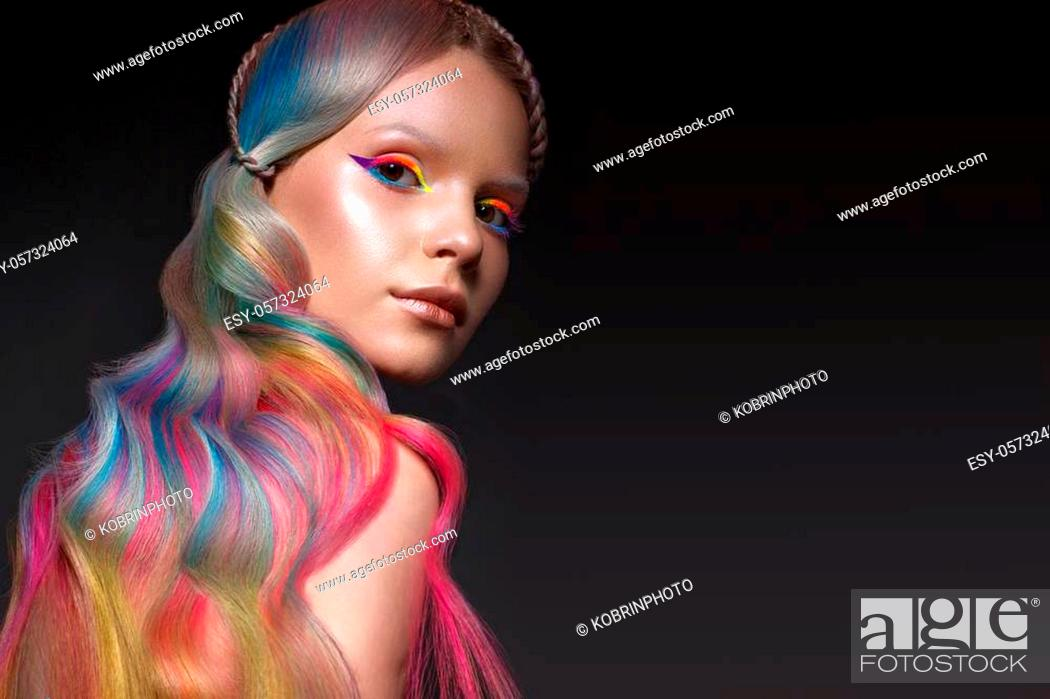 Stock Photo: Beautiful girl with multi-colored hair and creative make-up and hairstyle. Beauty face. Photo taken in the studio.