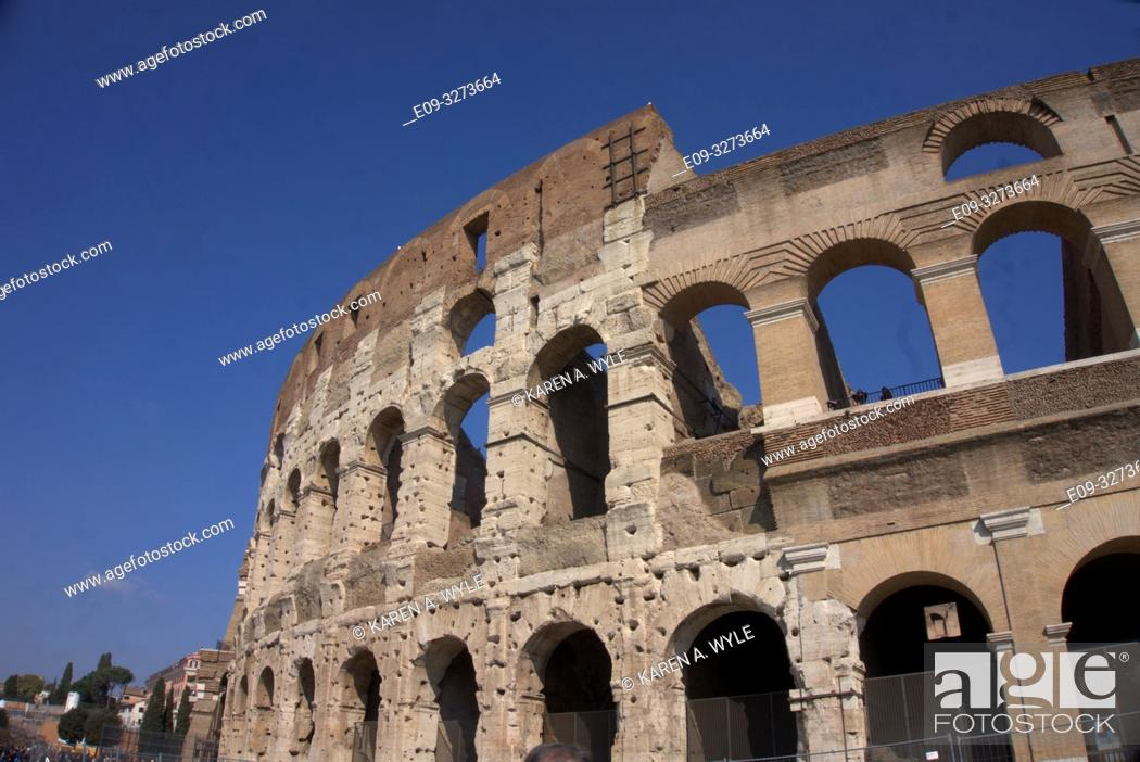 Stock Photo: portion of exterior of Colosseum, riddled with holes - Rome, Italy.
