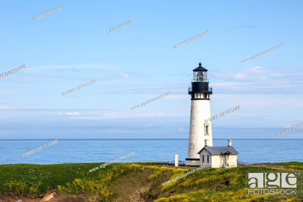 Stock Photo: The Yaquina lighthouse, also known as the Foulweather Lighthouse, was built in the 19th Century, to guide mariners off the rugged coast of Oregon.