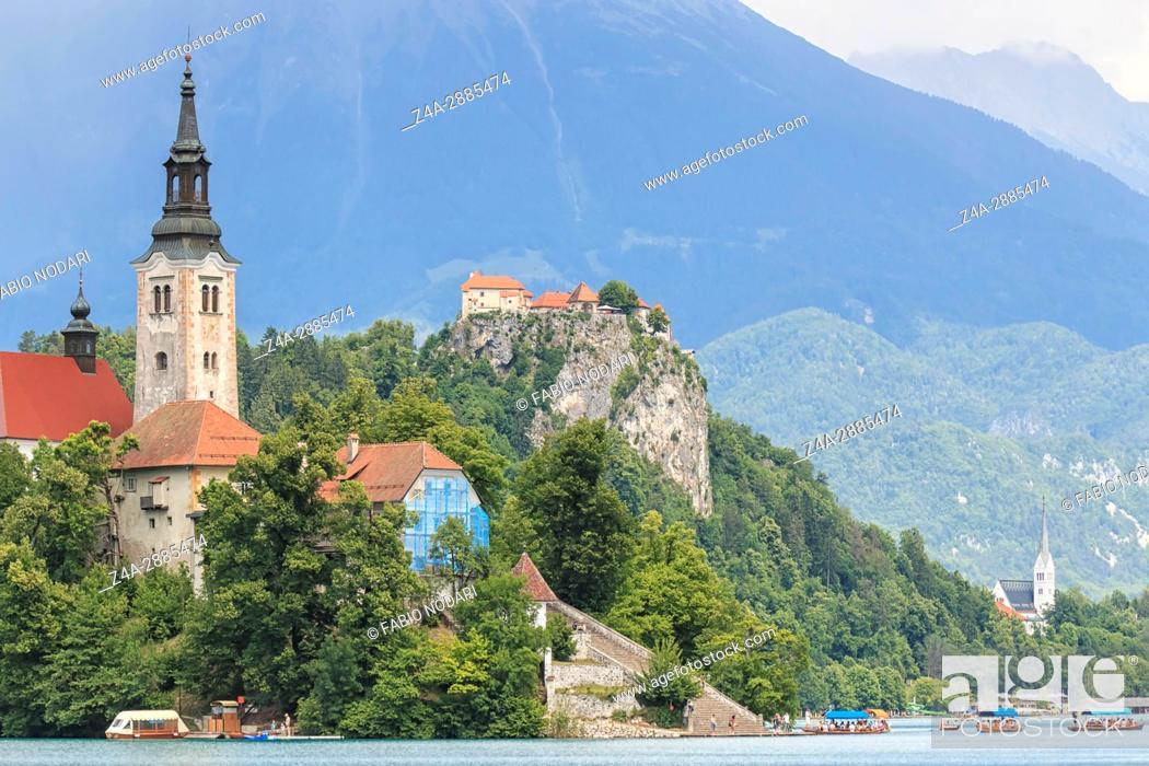 Stock Photo: Bled, Slovenia - June 3, 2017: Tourists visiting the Cerkev Marijinega vnebovzetja Church in the Island in the center of Lake Bled.