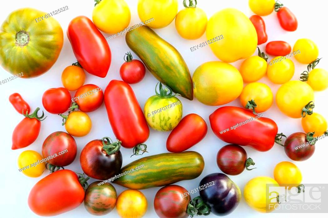 Photo de stock: Colorful different kind tomatoes on white background.