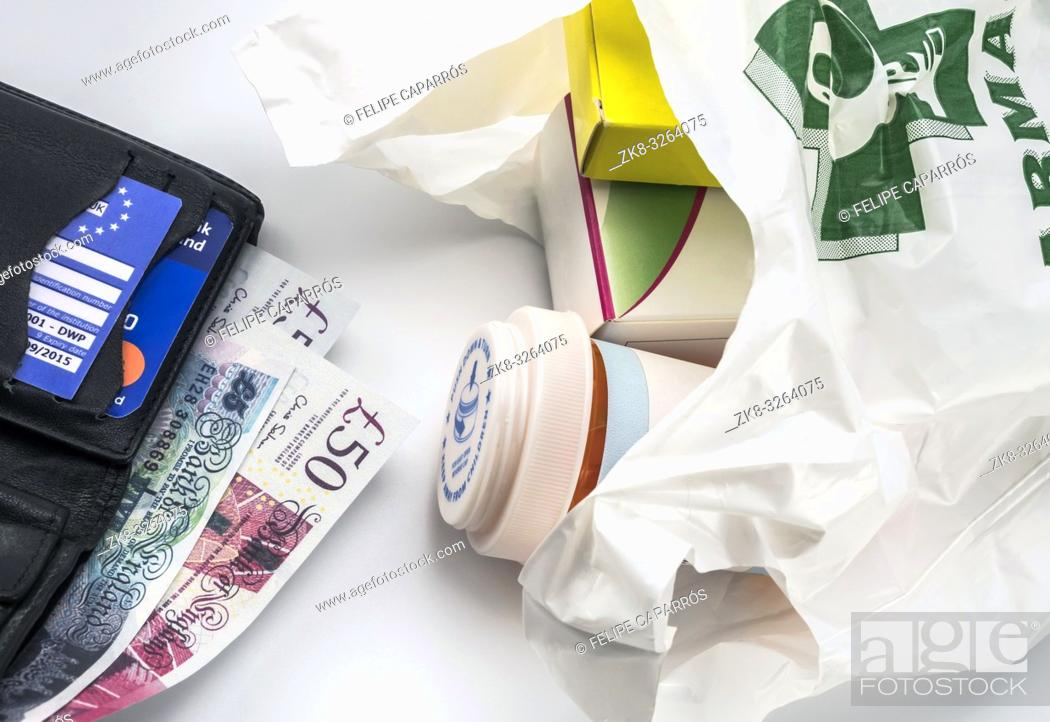 Stock Photo: European health insurance card in a wallet along with several pounds sterling and medicines in a bag, concept of medical increase in the crisis of the brexit.
