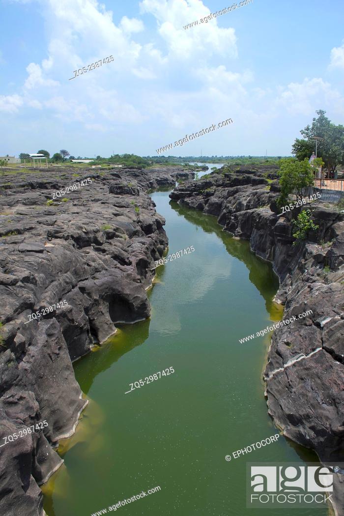 Stock Photo: Naturally created potholes (tinajas) on the riverbed of the Kukadi River, Nighoj, Ahmednagar District, Maharashtra.