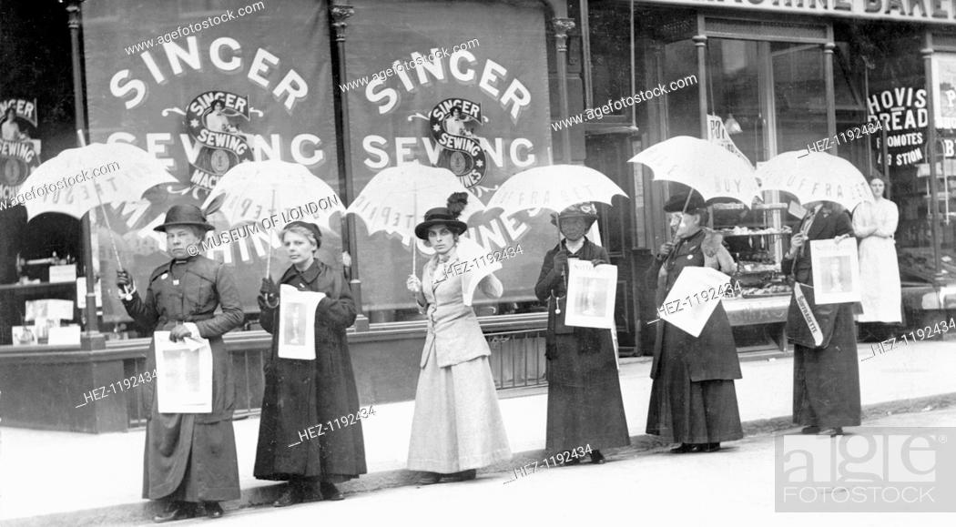 Stock Photo: A parasol parade selling The Suffragette newspaper, Brighton, Sussex, April 1914. From left to right: Miss Reid, Mrs Goodier, Miss Gye, Mrs Brandon, Miss Rae.