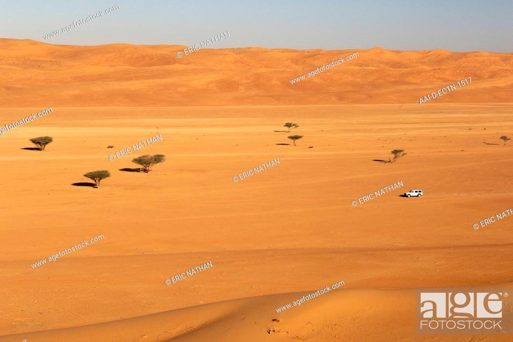 4X4 driving through Wahiba Sands Ramlat al Wahaybah in Oman, Stock