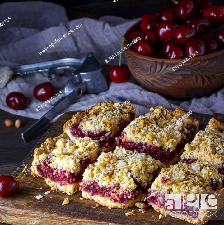 Photo de stock: square pieces of cake crumble on brown wooden board, top view.