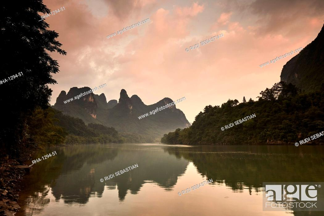 Stock Photo: Sunrise reflected in the Li River, Guilin, China, Asia.