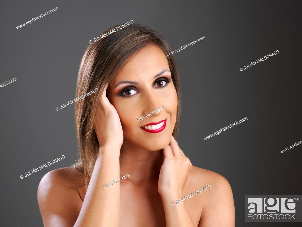 Stock Photo: Young woman showing her beauty.