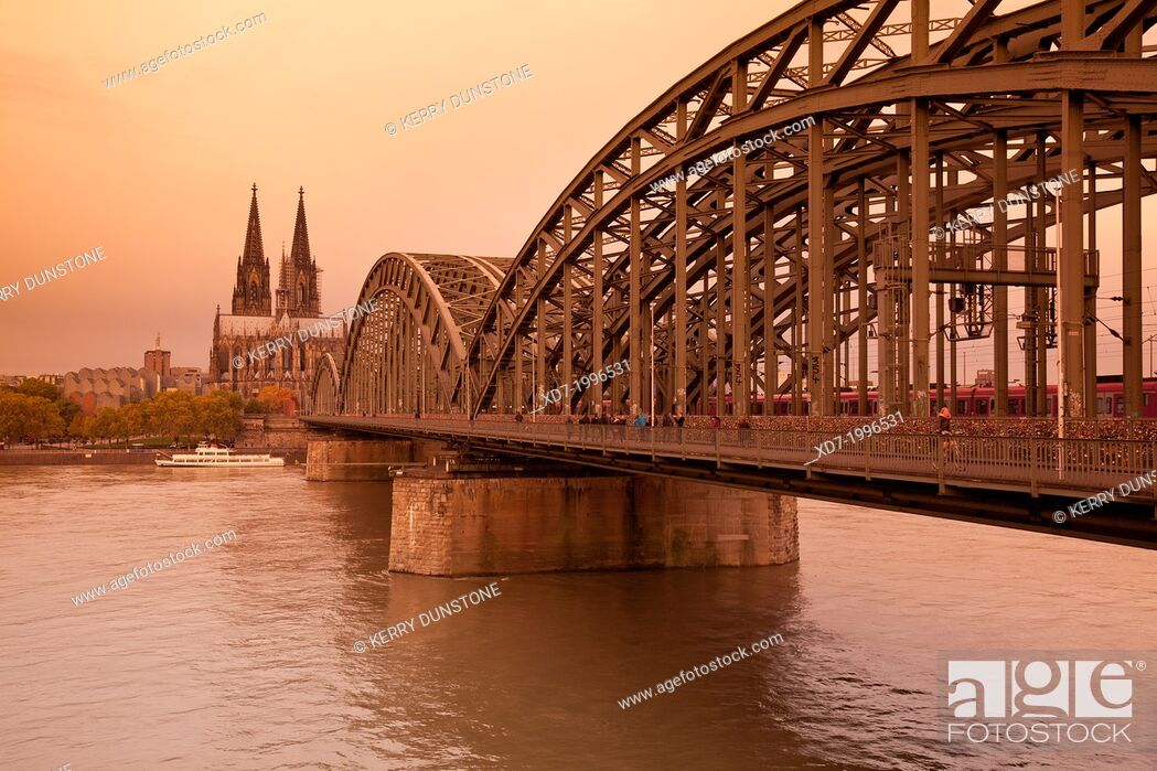 Stock Photo: Cologne Cathedral with River Rhine and Hohenzollern Brucke (Bridge), Cologne, Rhine-Westphalia, Germany.