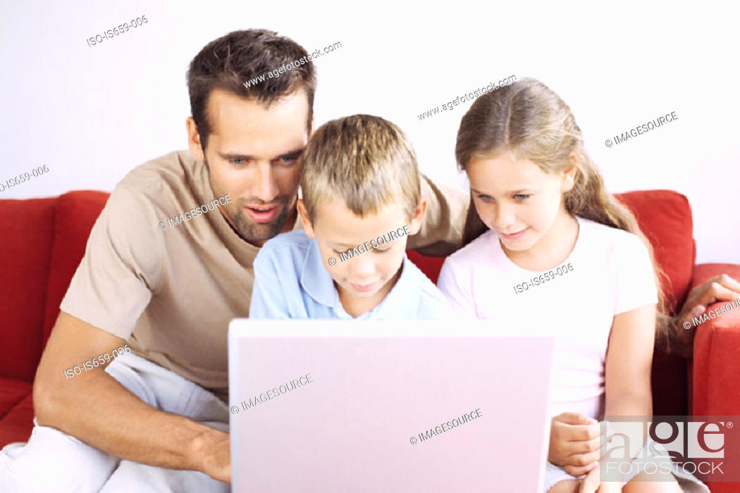 Stock Photo: Father and children using laptop.