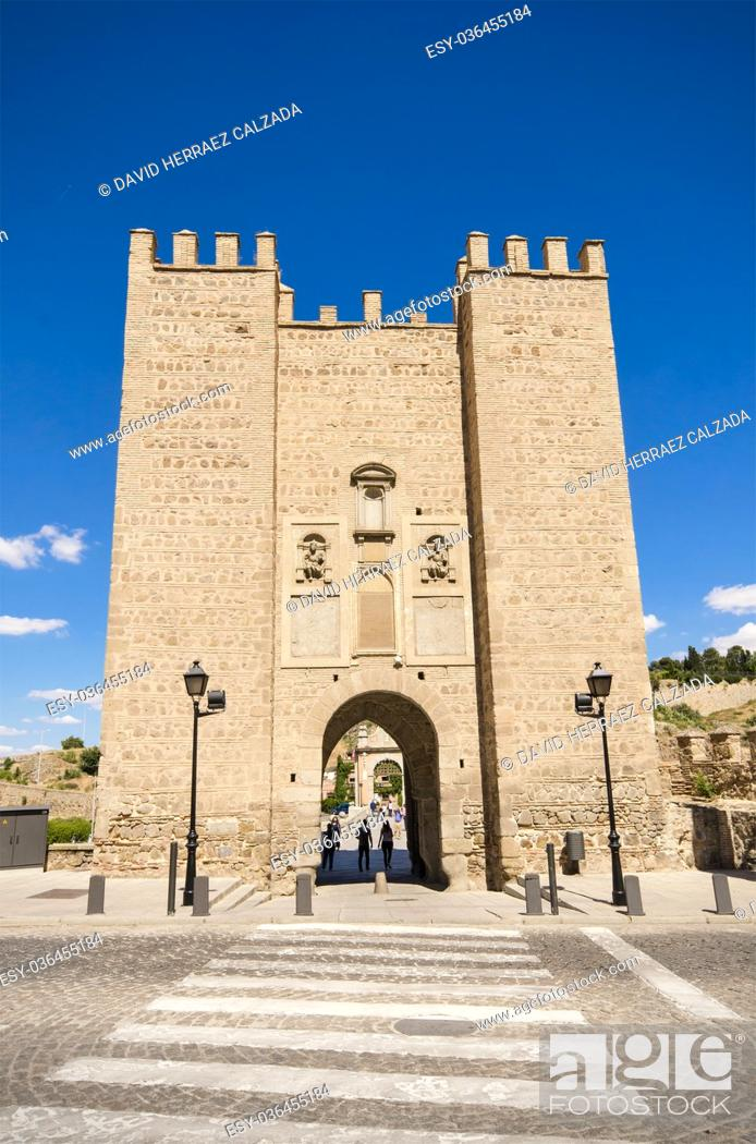 Stock Photo: Ancient medieval gate on May 24, 2015 in Toledo, Spain.