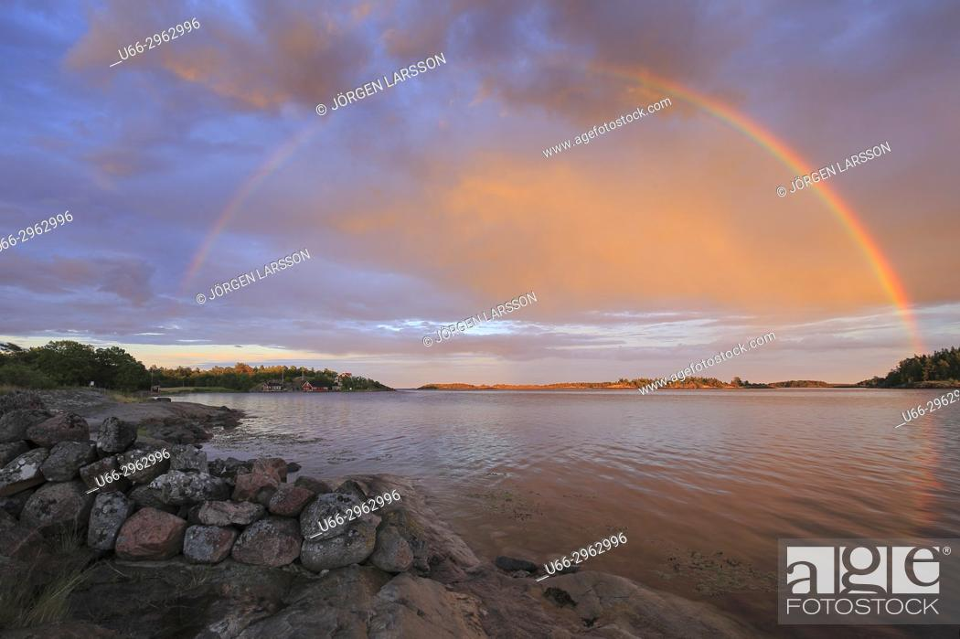 Stock Photo: Rainbow over Navelso, Smaland, Sweden.