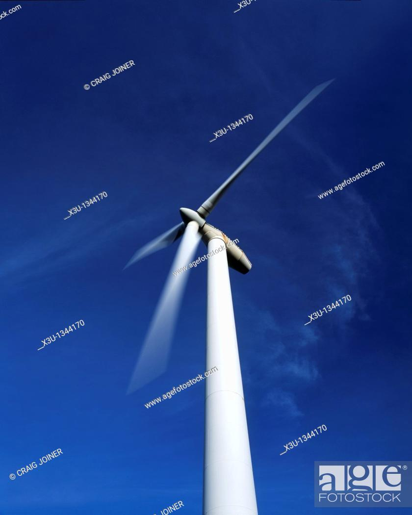 Stock Photo: A single wind turbine set against a blue sky at the Gilfach Goch Wind Farm near Bridgend and Pontypridd, Mid Glamorgan, Wales, United Kingdom.