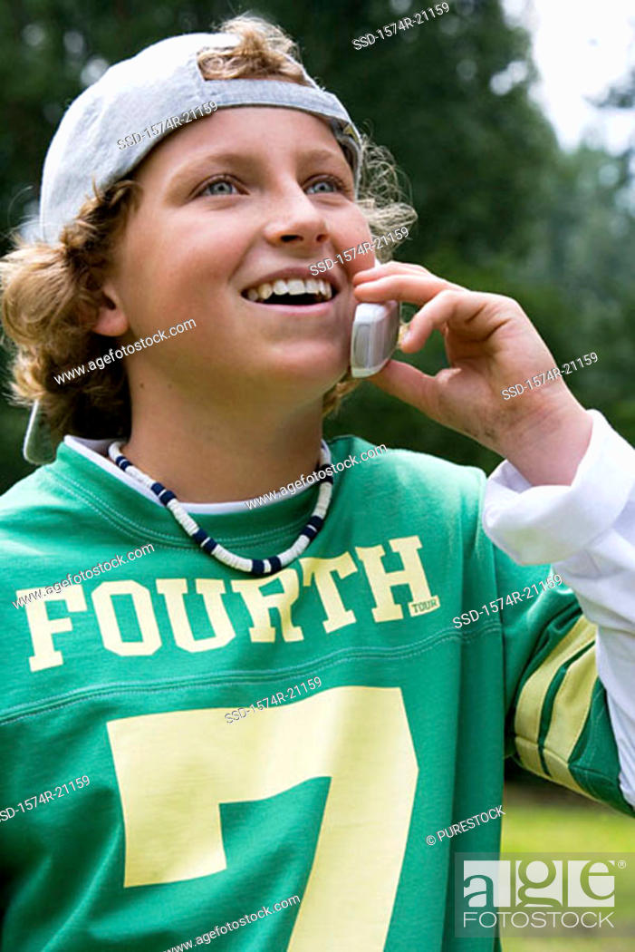 Stock Photo: Close-up of a boy talking on a mobile phone.