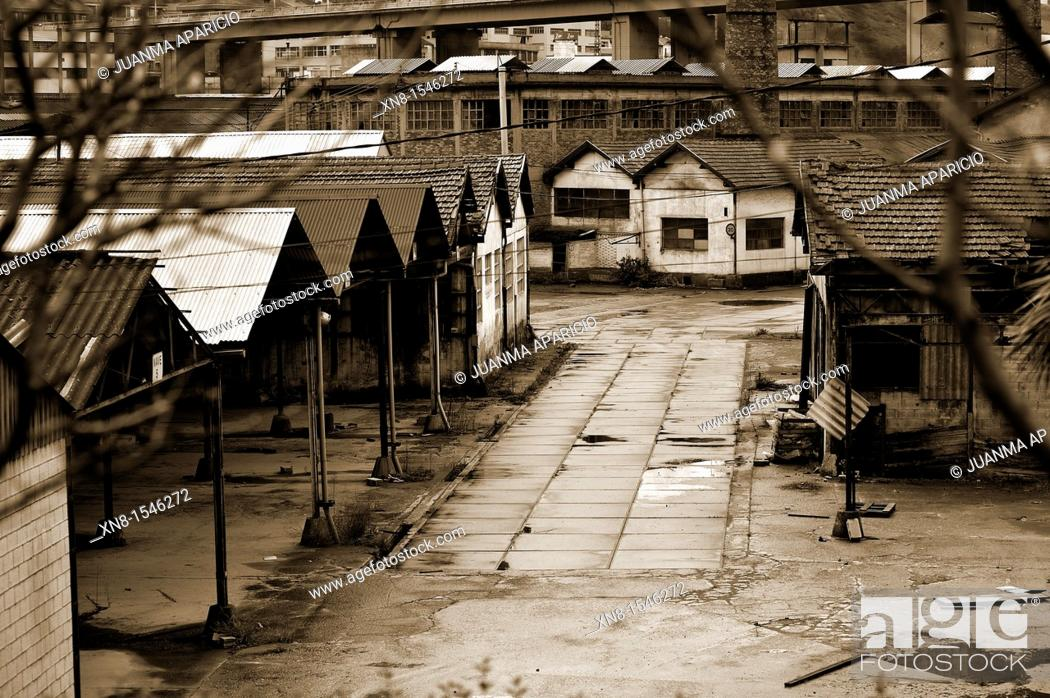 Stock Photo: Abandoned factory in sepia.