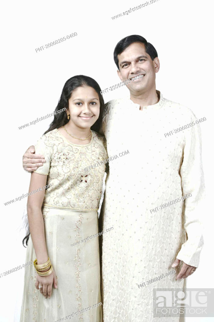 Stock Photo: Portrait of a mature man standing with his arm around his daughter.