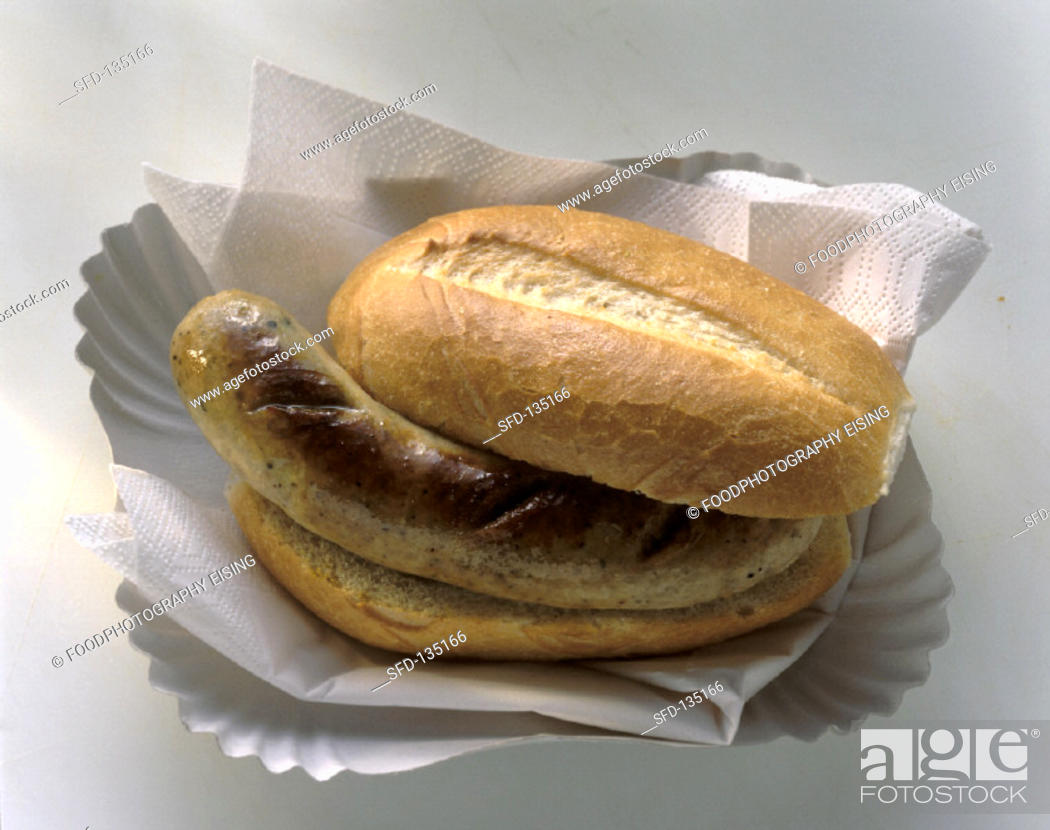 Stock Photo: A sausage (Bratwurst) in a roll on paper plate.
