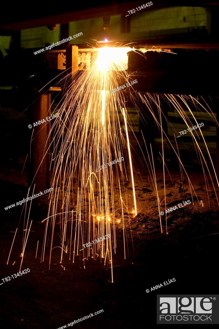 Stock Photo: industrial machine laser cutting iron, Sevilla.