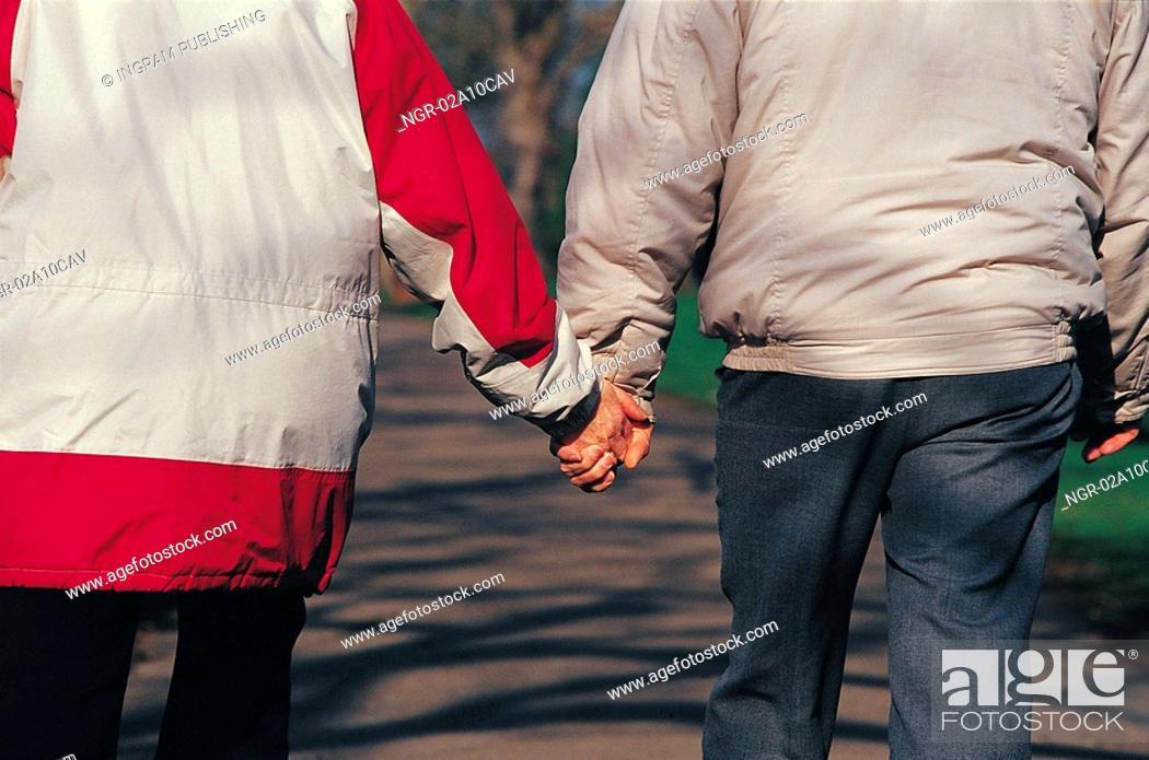 Stock Photo: couple talking a walk.