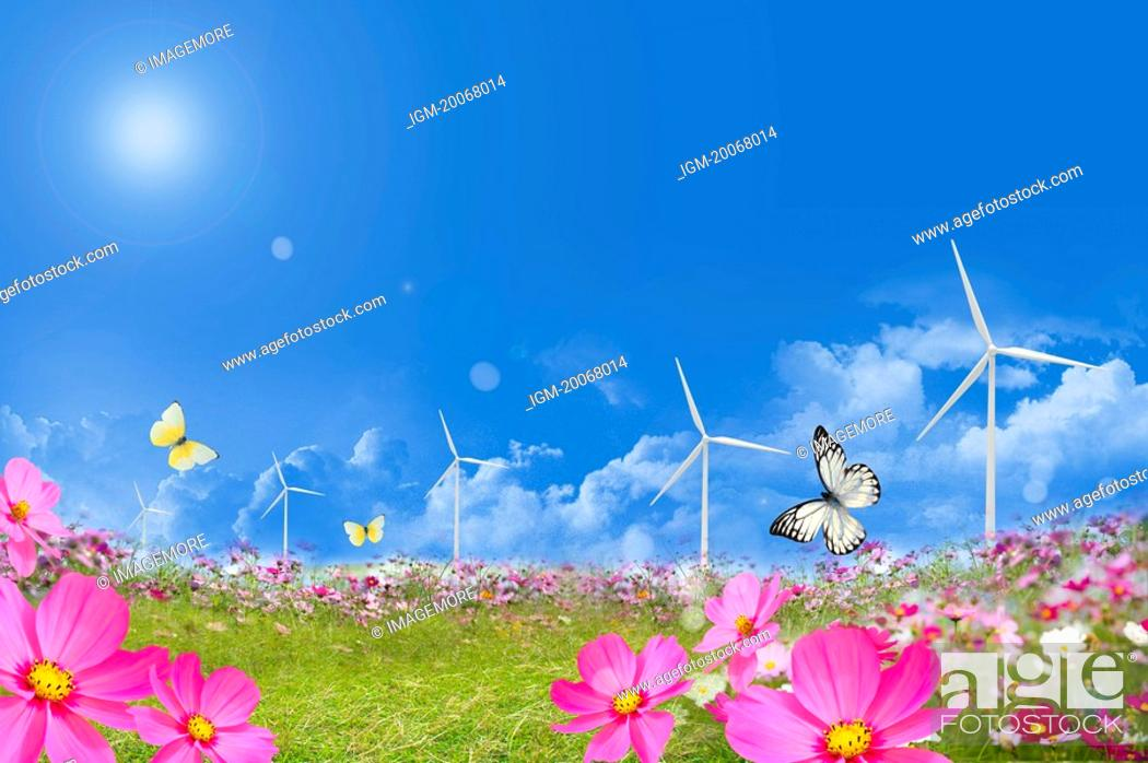 Stock Photo: Lohas, Environmental Conservation, Digitally generated image of flower field, butterflies and windmills in the blue sky.