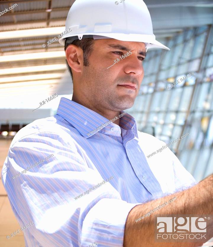 Stock Photo: Businessman inspecting construction site.