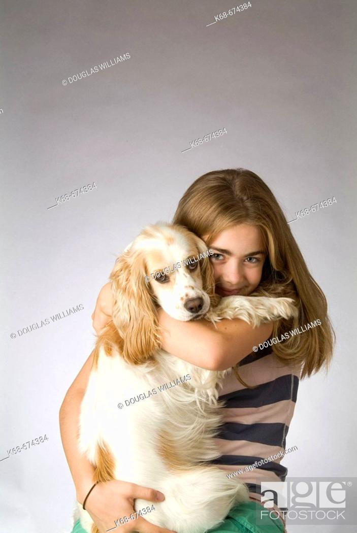 Stock Photo: twelve year old girl with cocker spaniel.