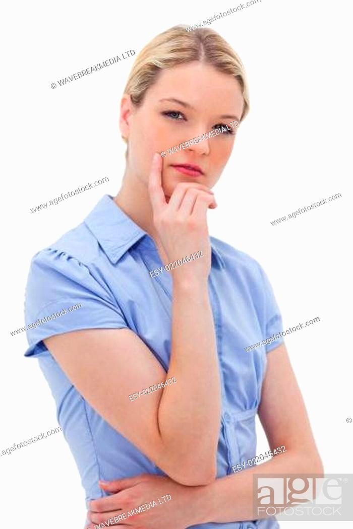 Stock Photo: Thinking woman standing.