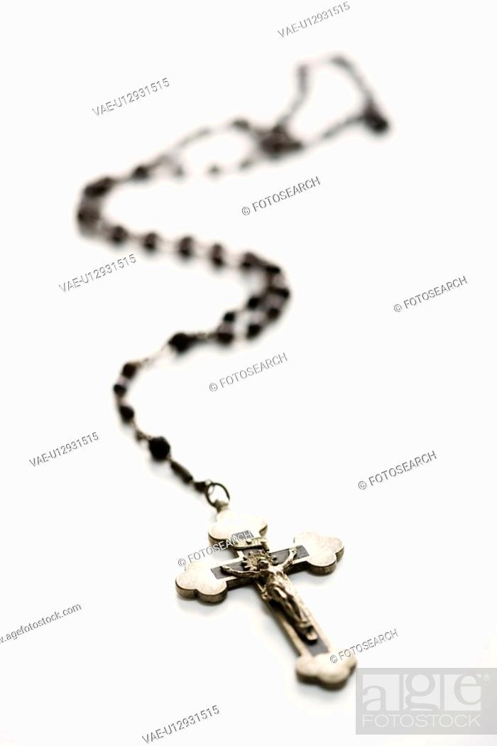 Stock Photo: Christian rosary beads with crucifix on white background.