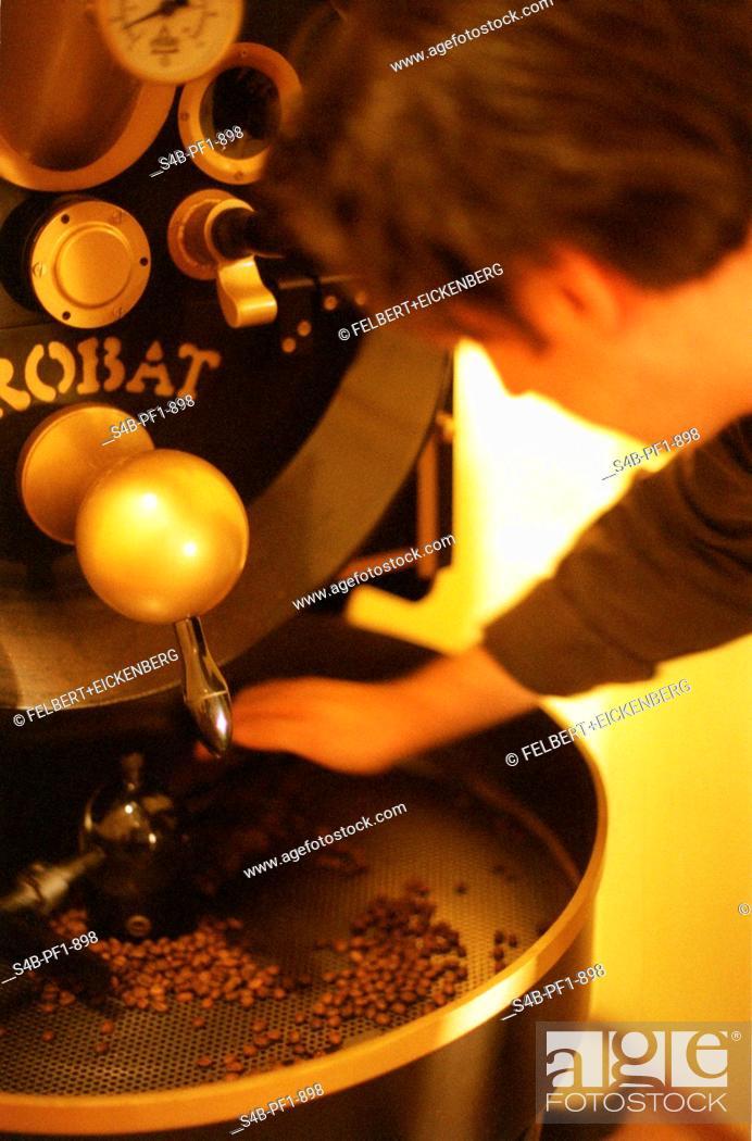 Stock Photo: Man grinds Coffee Beans - Munich - Bavaria - Germany.