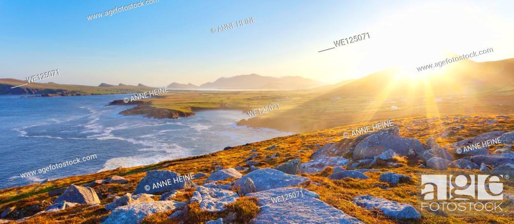 Stock Photo: irish coastline on a clear early morning, location: dingle peninsula in co.kerry,western ireland,Waymont near Graigue,52.151437,-10.475927.