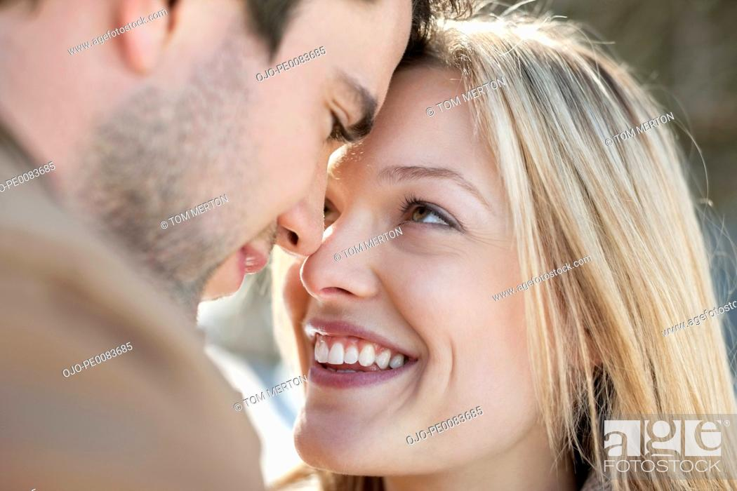 Stock Photo: Close up of smiling couple face to face.