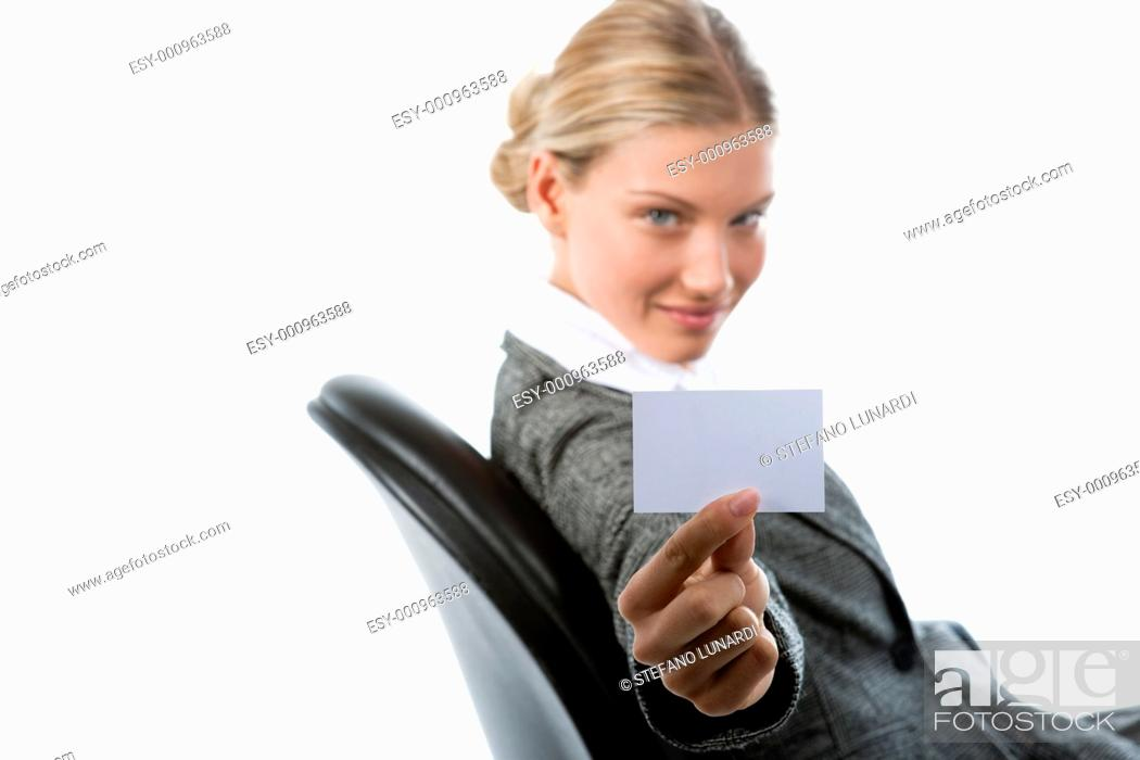 Stock Photo: Beautiful young woman holding a blank card.