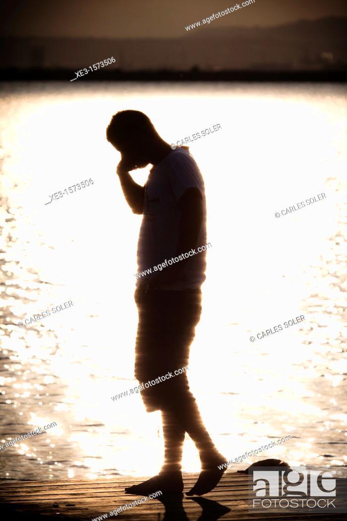 Stock Photo: Phone talking at sunset.