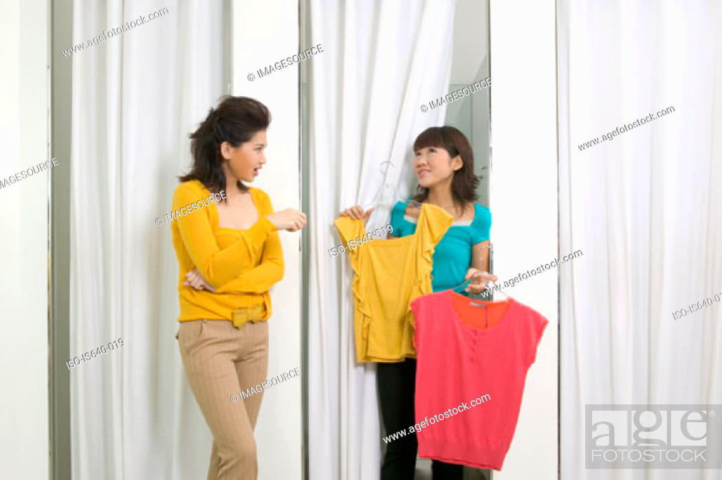 Stock Photo: Two women in clothes store.