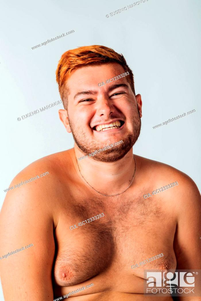 Stock Photo: Portrait of a young man with bare chest, smiling.