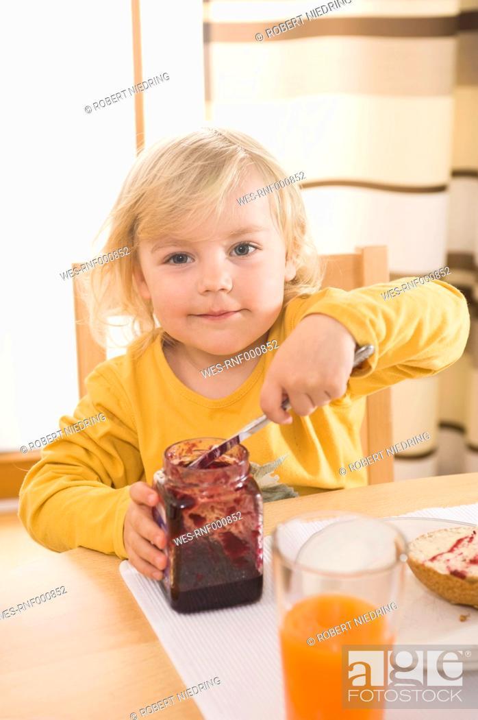 Stock Photo: Girl having breakfast, smiling, portrait.