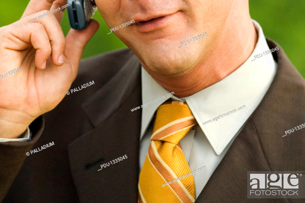 Stock Photo: Close-up of a mature man talking on a mobile phone.