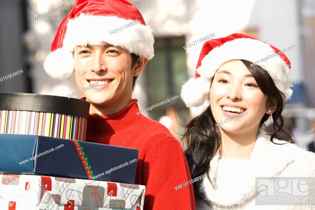 Stock Photo: Japanese young couple enjoy shopping.