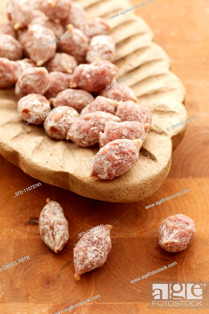 Stock Photo: Salami pralines in a wooden dish.