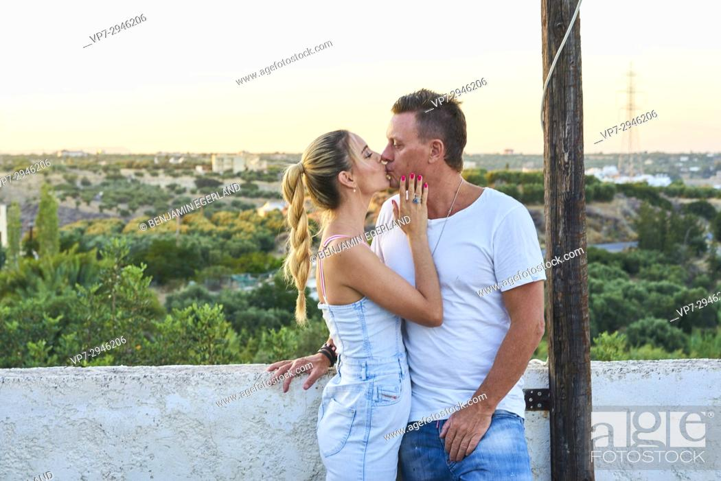 Imagen: romantic couple kissing during sunset. Australian ethnicity. During holiday stay in Hersonissos, Crete, Greece.