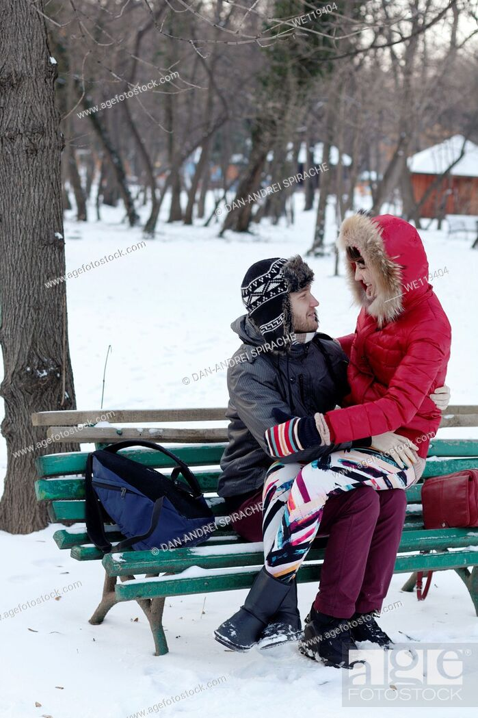Stock Photo: Couple spending a day in a snowy park in Bucharest, Romania.