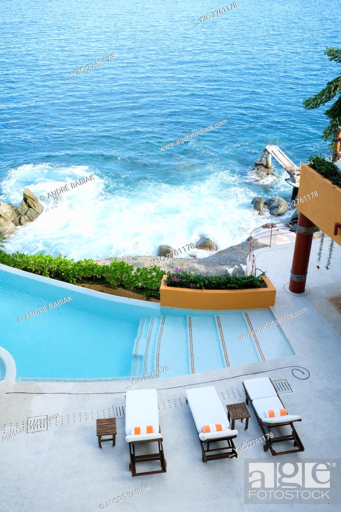Stock Photo: Ocen front property terrace with infinity swimming pool, view from above. Puerto Vallarta South Shore, Jalisco, Mexico.