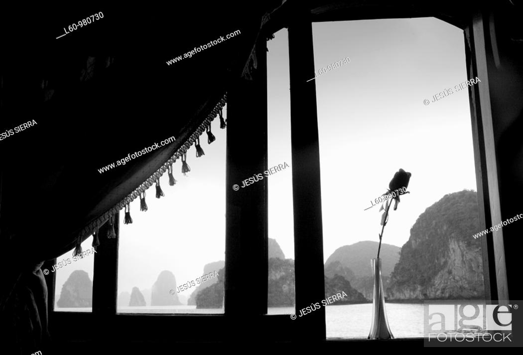 Stock Photo: Flower in the window, Halong Bay, Vietnam.