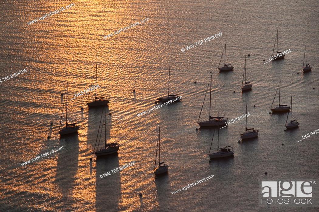 Stock Photo: USA, Massachusetts, Boston, Boston Harbor sunrise reflection with sailboats, high angle view, dawn.